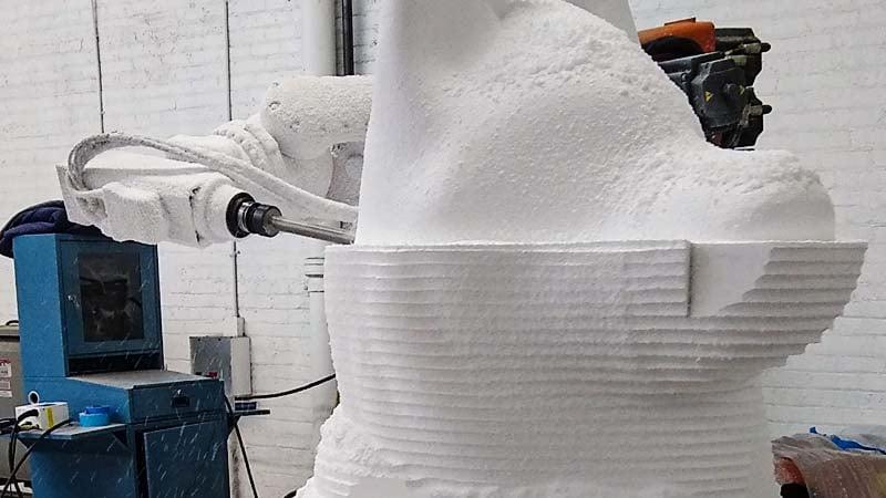 7 axis CNC robot carving a foam sculpture